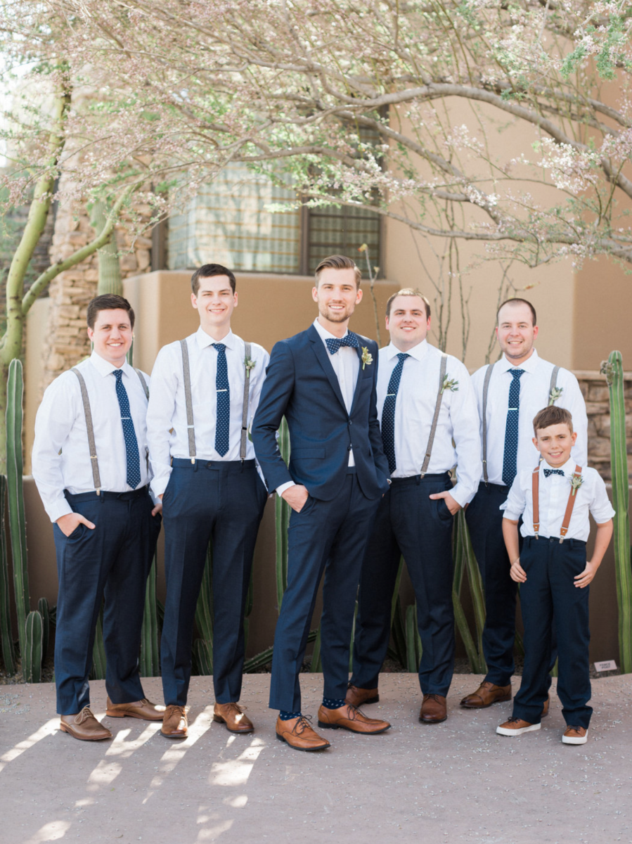 A groom stands with his groomsmen on his wedding day at The Gallery Golf Club
